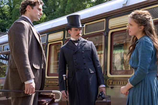 Генри Кавилл на новом кадре из «Энолы Холмс» от Netflix: Шерлок, Майкрофт и их юная сестренка